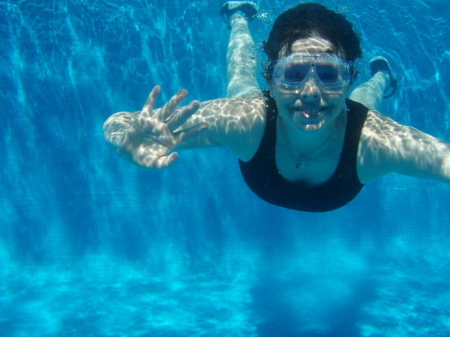woman in pool underwater