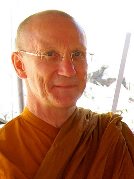 head shot of a smiling monk
