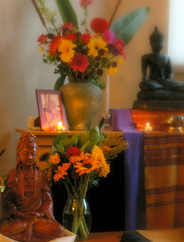 Fres flowers and a Buddha statue on an alter