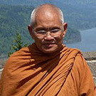 Monk with view of river in background