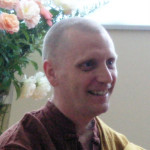 head shot of a monk smiling